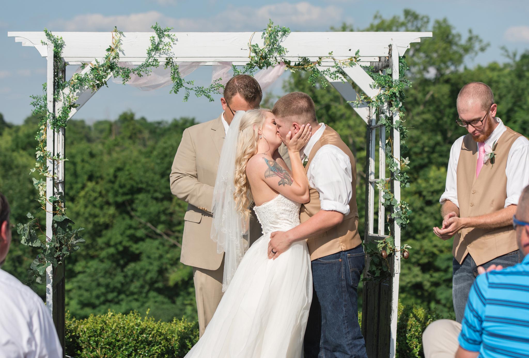 first kiss, bride and groom, Kentucky wedding photographer, Josephina Event venue, barn wedding, KY bride, Dry Ridge, Lexington, Somerset, Louisville, Ashland, Winchester, Campton, Mt Sterling, West Chester