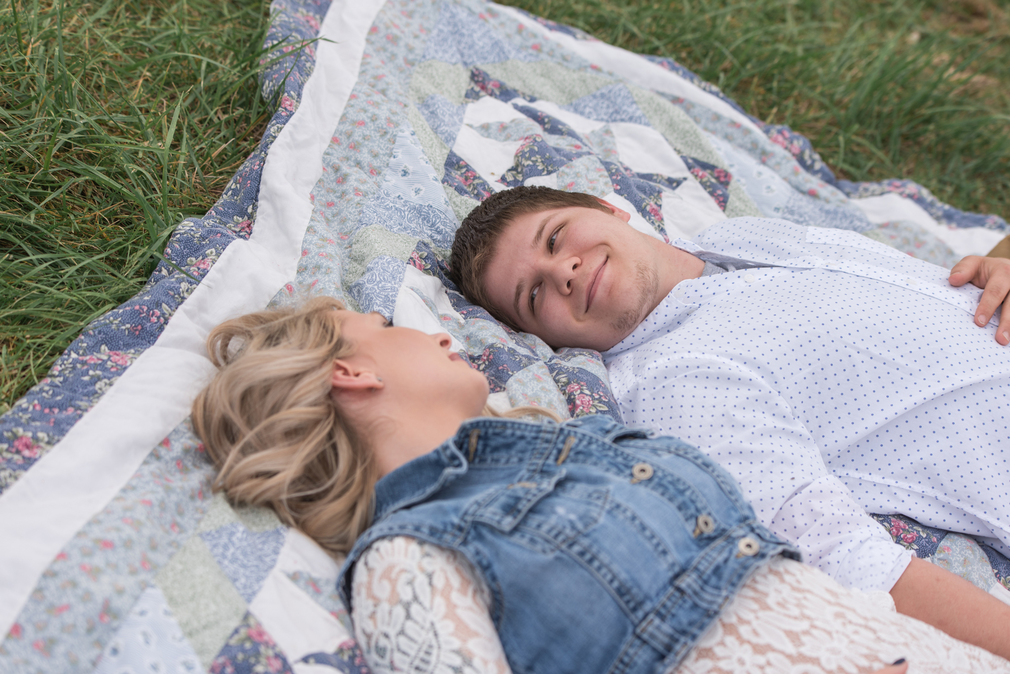 Lexington KY engagement photography of couple on picnic blanket smiling at each other