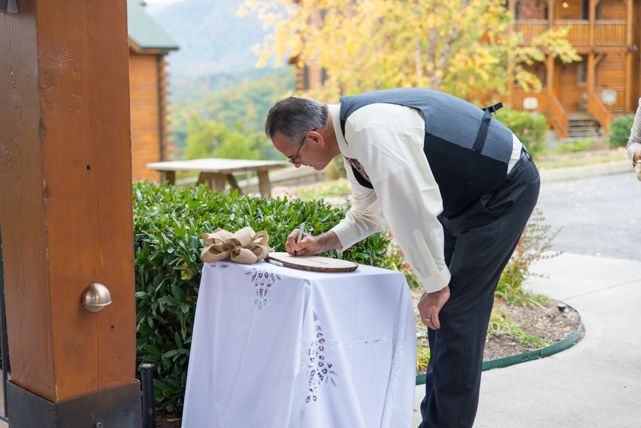 Guest signing guestbook at Gatlinburg, TN wedding