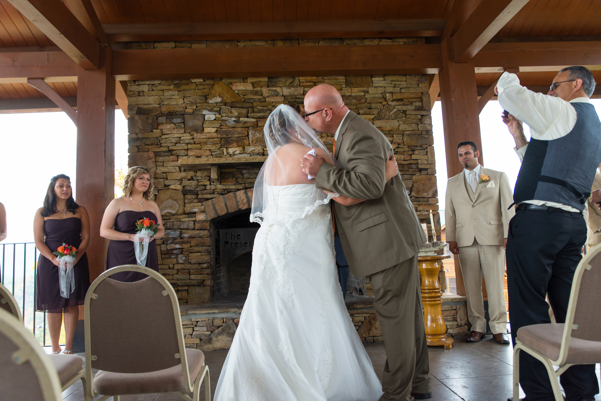 Father and bride hugging