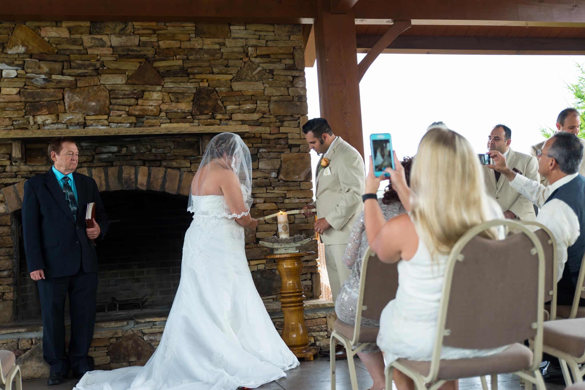 Bride and groom lighting unity candle at Gatlinburg, TN wedding