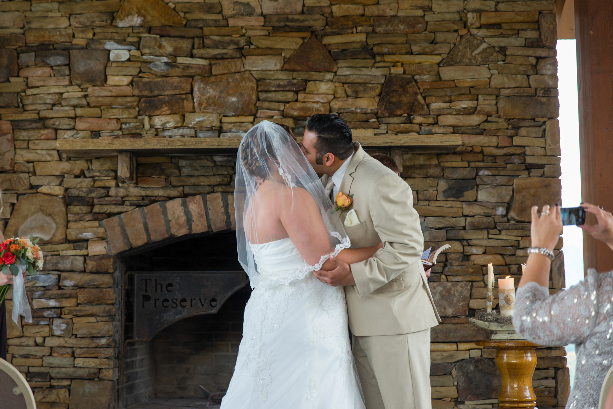 Bride and groom's first kiss at Gatlinburg, TN wedding