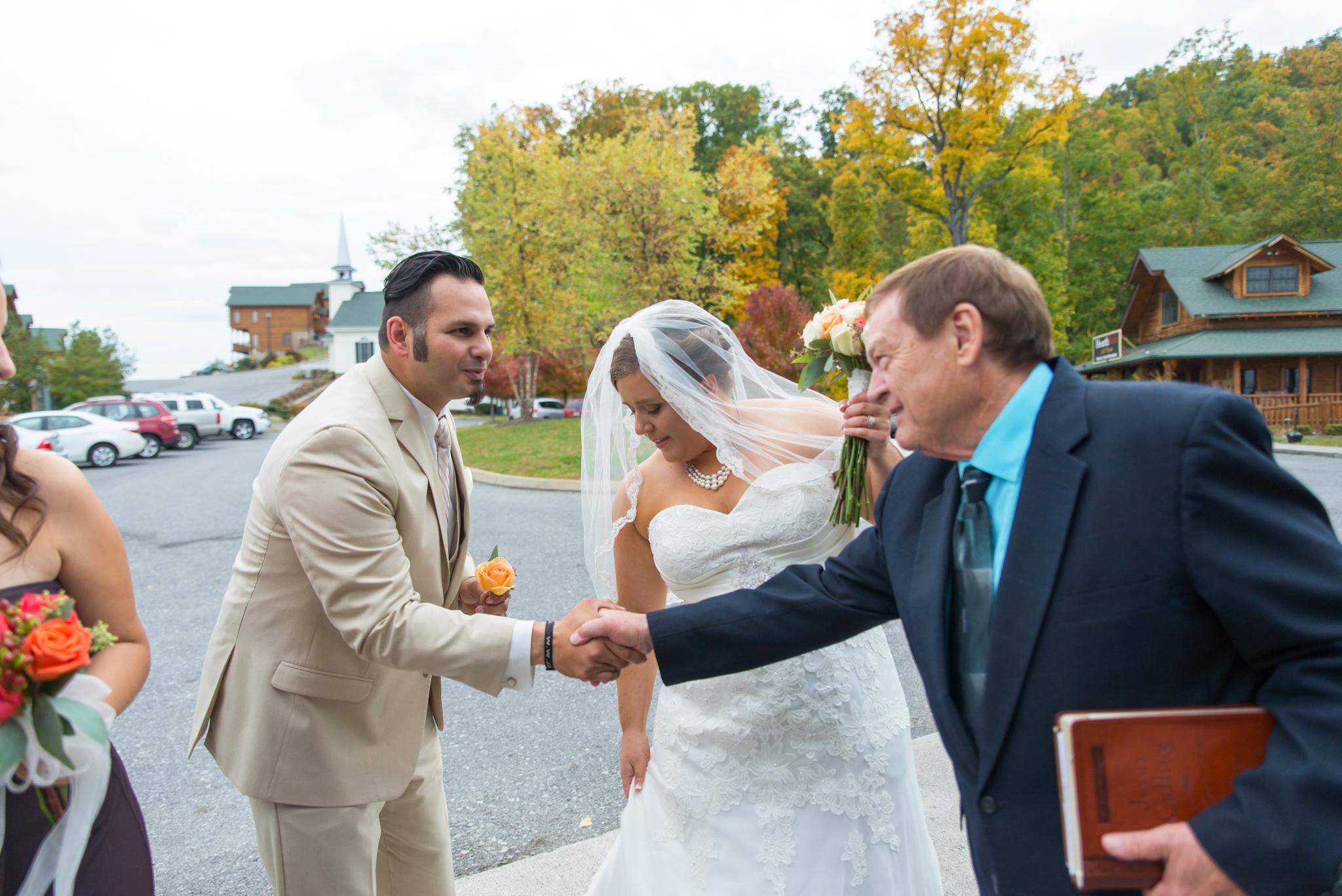 Groom shaking officiant's hand after Gatlinburg wedding