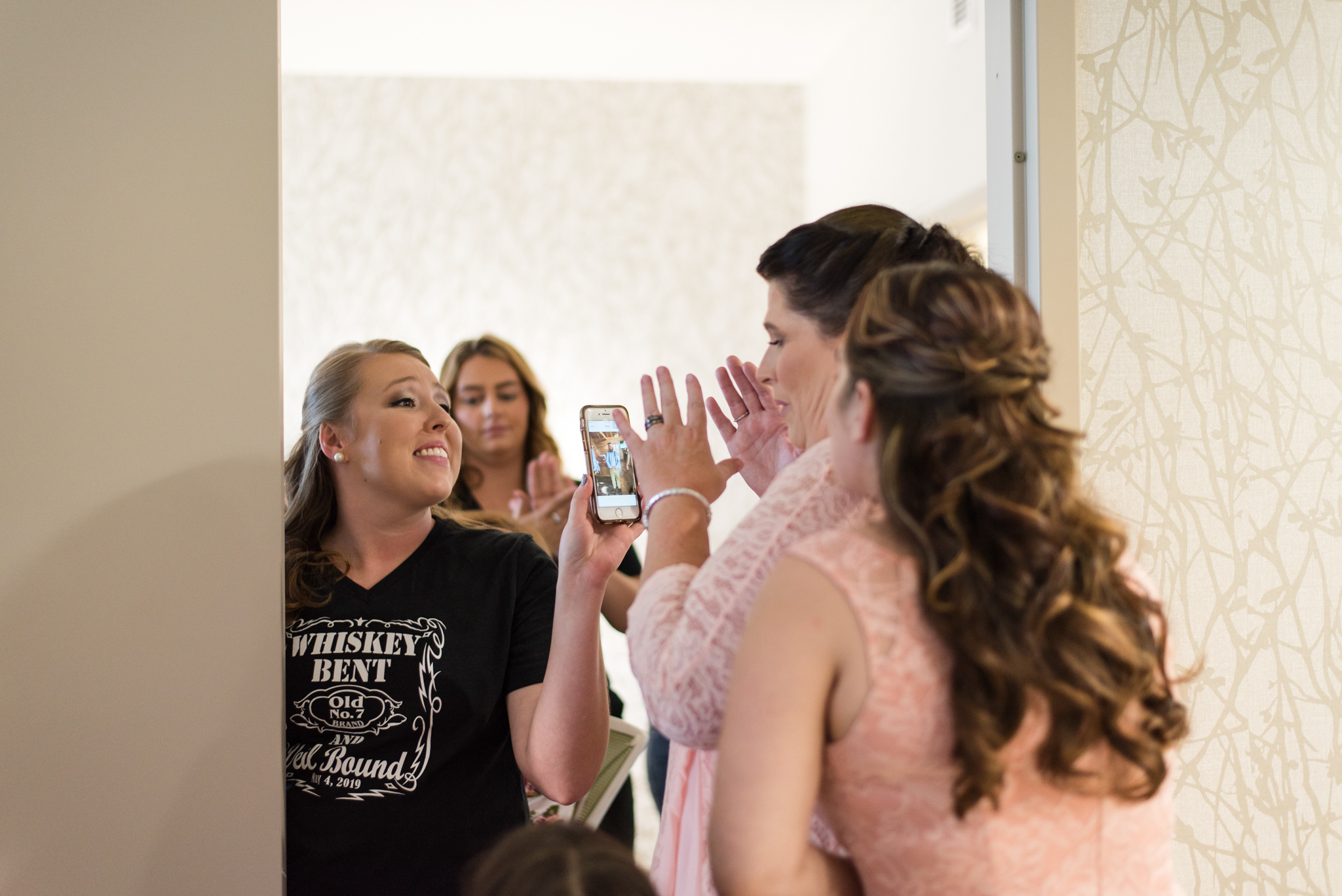 mother of groom reacting to his photo