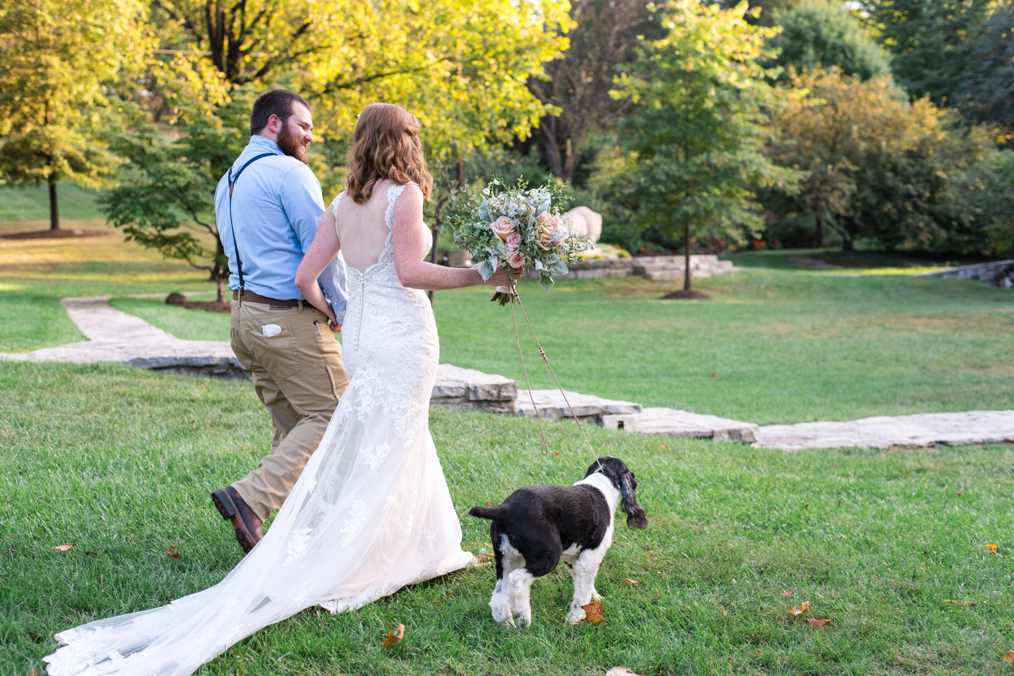 bride, groom, and their dog