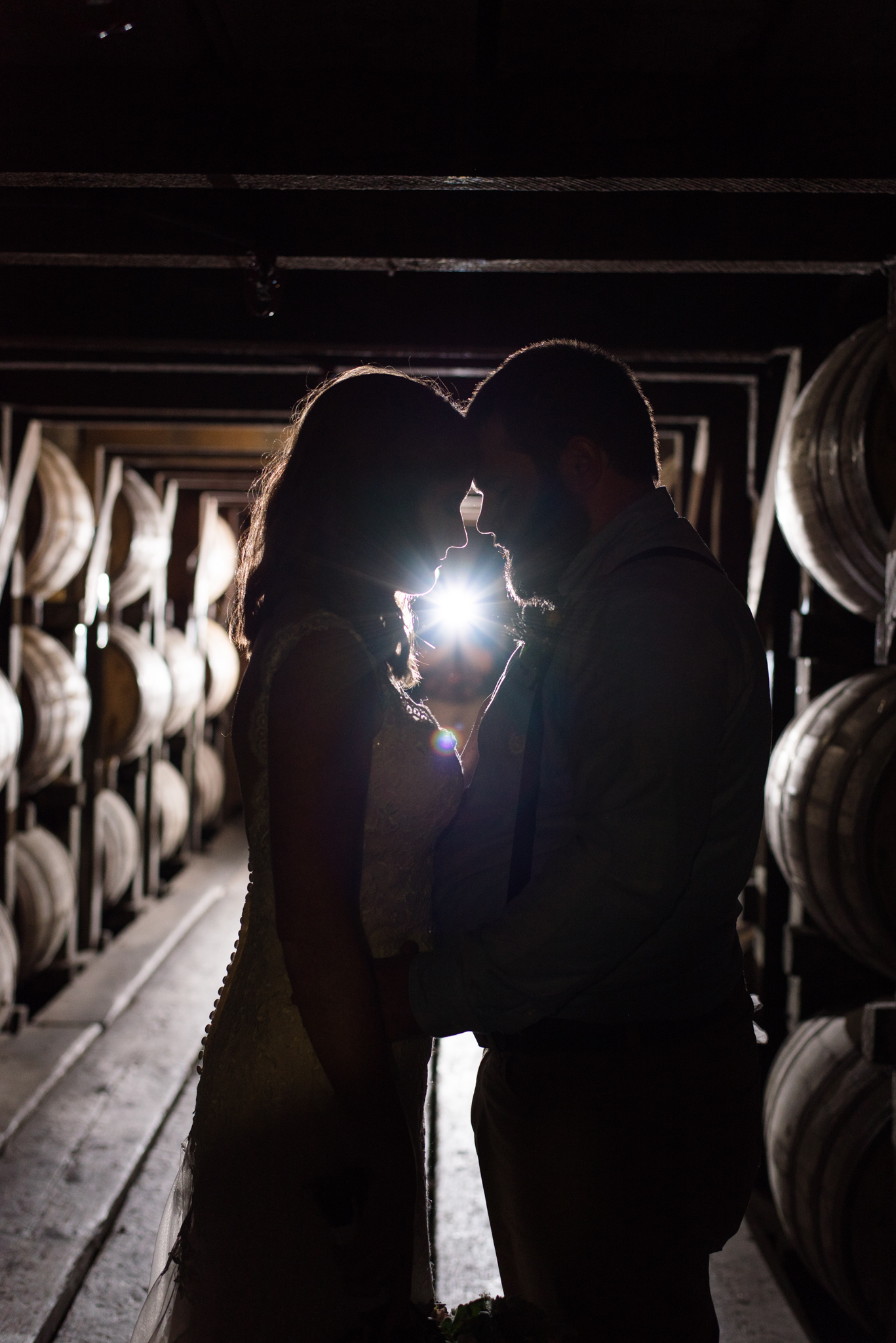 bride and groom in barrel house