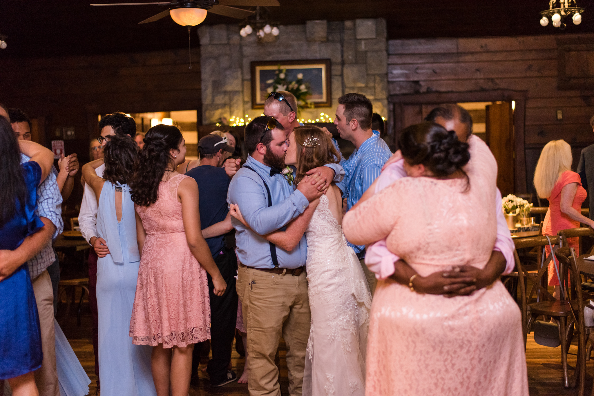 bride and groom kiss during reception at buffalo trace distillery